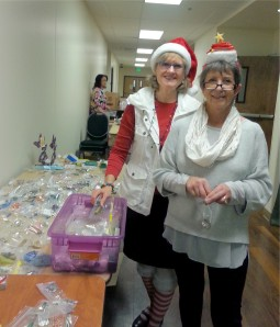 Dottie and Gloria organize the gifts.