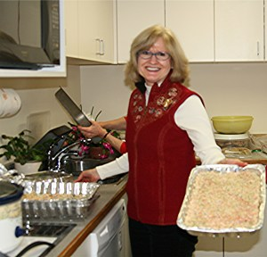 Dottie prepares rice krispie treats for PSS holiday party.