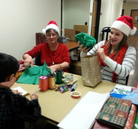 Linda and Chloe wrap gifts for the children.
